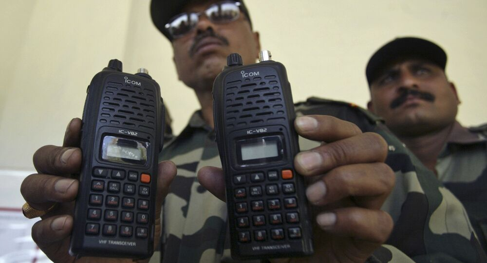 An Indian army officer displays satellite phones at Nagrota military station on the outskirts of Jammu, India, Monday, March 29, 2010