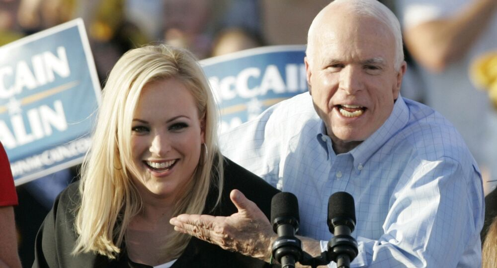 In this Aug. 30, 2008, file photo, former Republican presidential candidate, Sen. John McCain, right, introduces his daughter Meghan at a campaign stop in Washington, Pa. John McCain, the war hero who became the GOP's standard-bearer in the 2008 election, died Saturday, Aug. 25, 2018. He was 81.