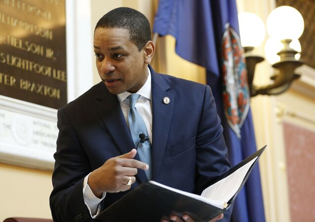 Virginia Lt. Gov Justin Fairfax looks over a briefing book prior to the start of the senate session at the Capitol in Richmond, Va., Thursday, Feb. 7, 2019. A California woman has accused Fairfax of sexually assaulting her 15 years ago.