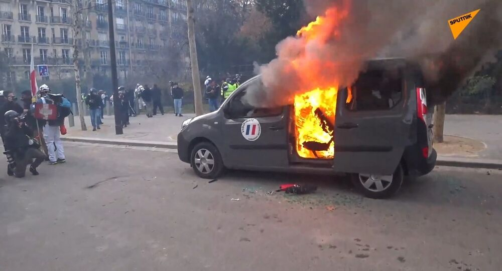 A car set afire amid Yellow Vests protests in Paris