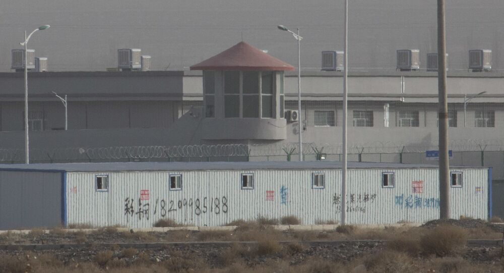 a guard tower and barbed wire fences around a facility in the Kunshan Industrial Park in Artux in western China's Xinjiang region, one of a growing number of internment camps in the region, where by some estimates 1 million Muslims are detained, forced to give up their language and their religion and subject to political indoctrination