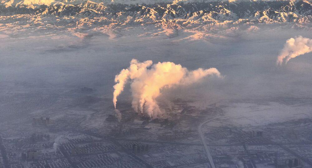 smoke stacks near the city of Urumqi China's northwestern region of Xinjiang