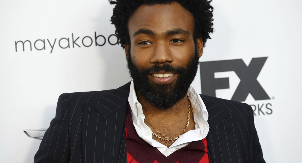 Donald Glover, creator and star of the FX series Atlanta, poses at a private cocktail party to celebrate the FX network's Emmy nominations, Sunday, Sept. 16, 2018, in Los Angeles.