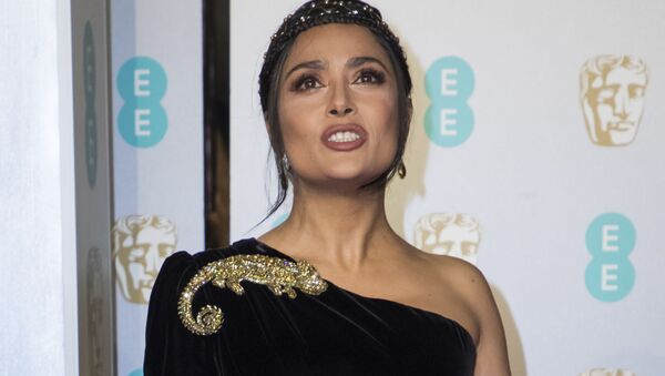 Salma Hayek poses for photographers upon arrival at the BAFTA awards in London, Sunday, Feb. 10, 2019. (Photo by Vianney Le Caer/Invision/AP) - Sputnik International