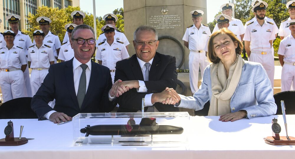 (L-R) Australian Defence Minister Christopher Pyne, Australian Prime Minister Scott Morrision and French Defence Minister Florence Parly shake hands after signing the Attack class submarine Strategic Partnering Agreement in Canberra, Australia, February 11, 2019