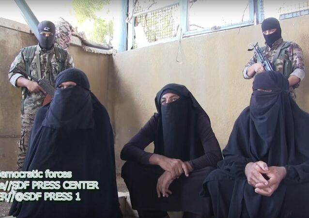 Kurdish forces capture terrorist militants trying to flee in hijabs. File photo.