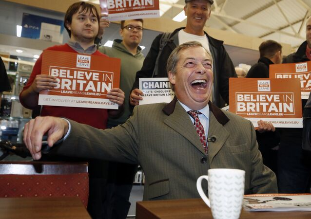 Vice-chairman of Brexit pressure group Leave Means Leave, Nigel Farage, relaxes with supporters in the market area of Bolton, England, during a campaign stop, Saturday Sept. 22, 2018.