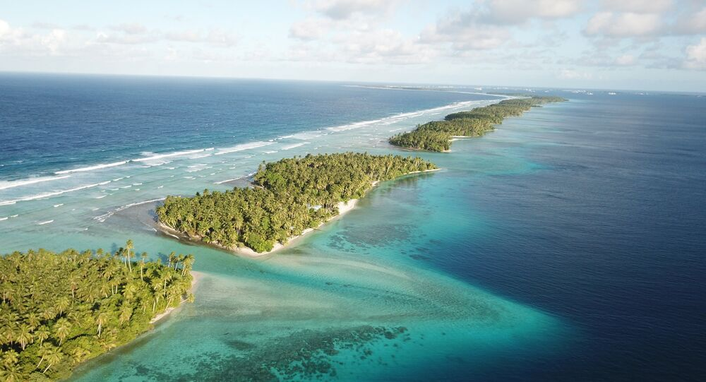 This Oct. 23, 2017 aerial photo shows the thin strip of coral atolls separating the ocean from the lagoon in Majuro, Marshall Islands