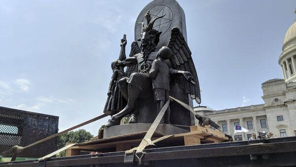 The Satanic Temple unveils its statue of Baphomet, a winged-goat creature, at a rally for the first amendment in Little Rock, Ark., Thursday, Aug. 16, 2018 - Sputnik International