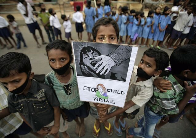 Indian children participate in a protest against child abuse and rising crimes against women, in Bhubaneswar, India, Saturday, March 16, 2013