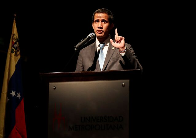 Venezuelan opposition leader Juan Guaido, who many nations have recognized as the country's rightful interim ruler, talks with students in Caracas, Venezuela February 11, 2019