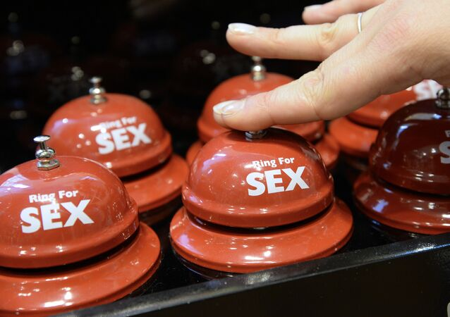 A picture taken on August 2, 2013 in a sex toy shop in Paris shows rings