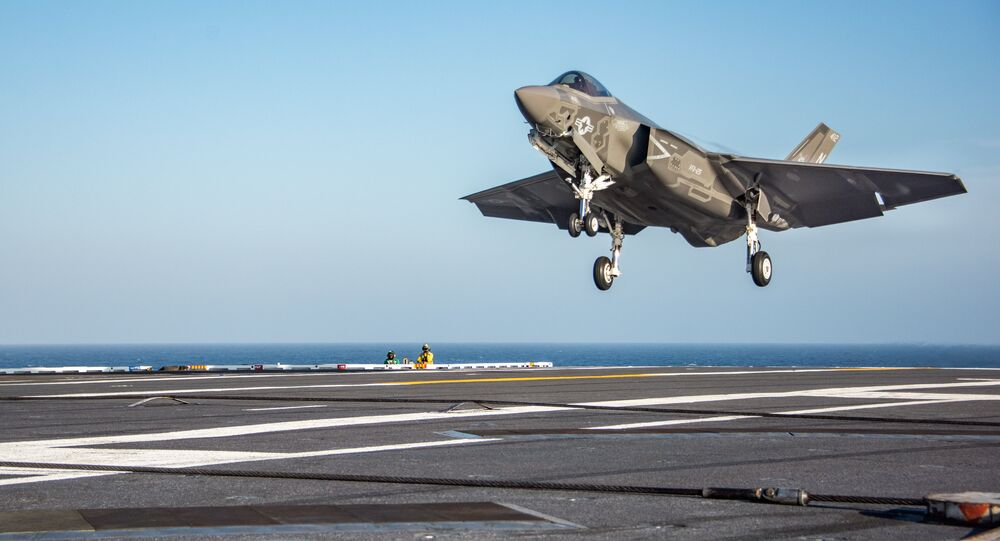 An F-35C Lightning II from the Rough Raiders of Strike Fighter Squadron (VFA) 125 prepares to make an arrested cable landing on the flight deck of the Nimitz-class aircraft carrier USS Carl Vinson (CVN 70). Carl Vinson is conducting fleet replacement squadron carrier qualifications off the coast of Southern California.