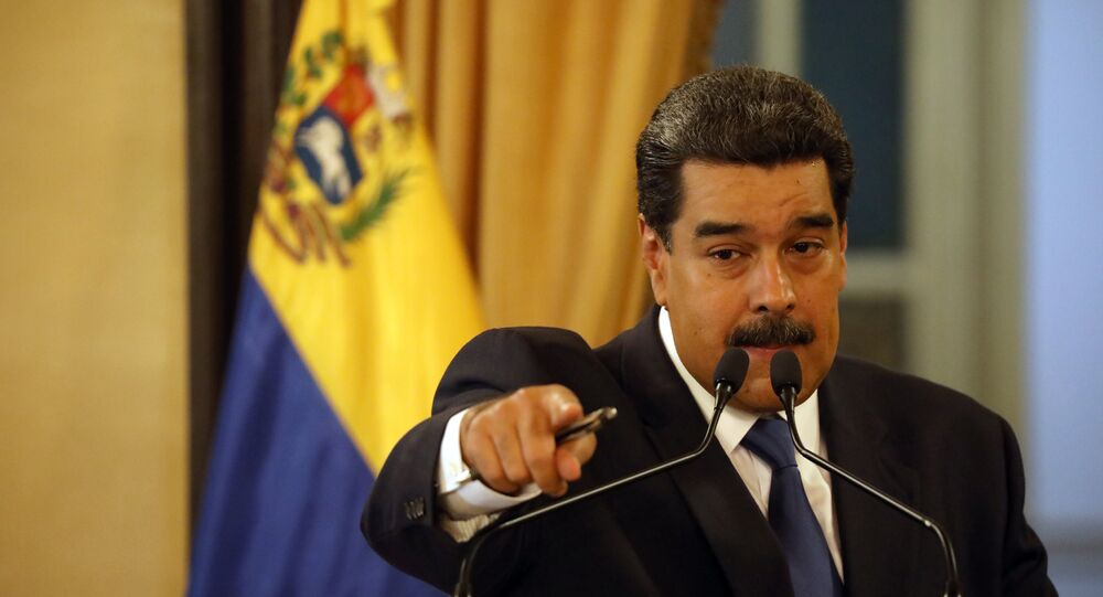 Venezuela's President Nicolas Maduro gestures during a news conference at Miraflores Palace in Caracas, Venezuela, February 8, 2019