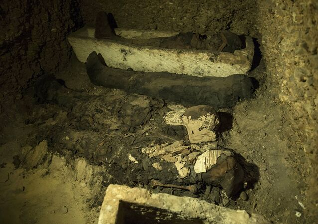Mummies and other artifacts lie in a recently discovered burial chamber in the desert province of Minya, south of Cairo, Egypt, Saturday, Feb. 2, 2019