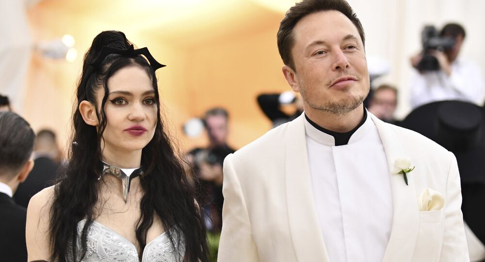 Grimes, left, and Elon Musk attend The Metropolitan Museum of Art's Costume Institute benefit gala celebrating the opening of the Heavenly Bodies: Fashion and the Catholic Imagination exhibition on Monday, May 7, 2018, in New York
