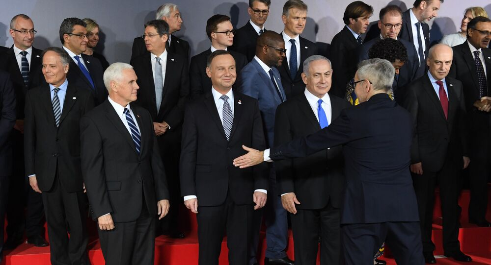 US Vice President Mike Pence, Poland's President Andrzej Duda and Prime minister of Israel Benjamin Netanyahu are seen during preparations for a family photo at the conference on Peace and Security in the Middle east in Warsaw, on February 13, 2019