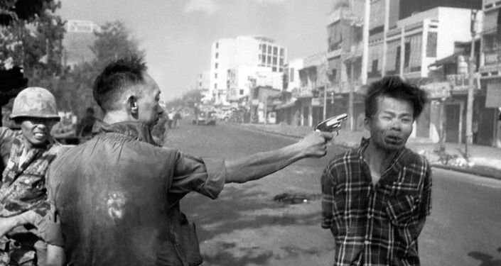 South Vietnamese General Nguyen Ngoc Loan, chief of the National Police, fires his pistol into the head of suspected Viet Cong officer Nguyen Van Lem (also known as Bay Lop) on a Saigon street, Feb. 1, 1968, early in the Tet Offensive