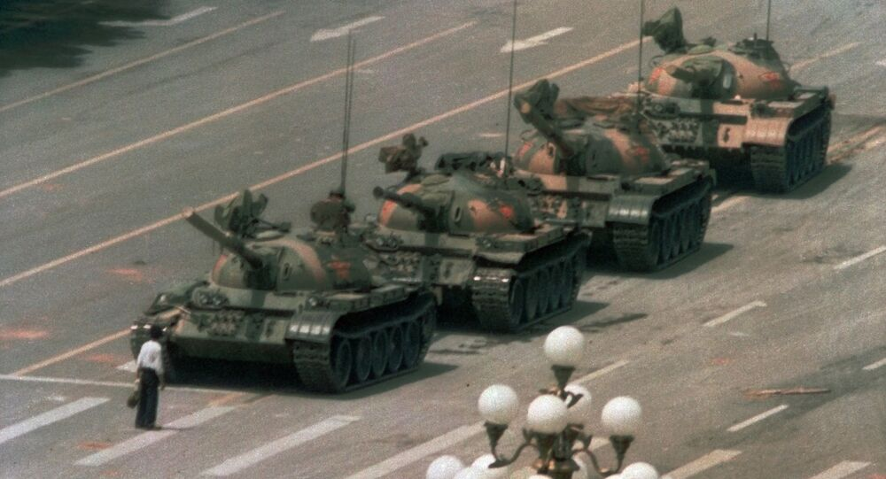 A Chinese man stands alone to block a line of tanks heading east on Beijing's Cangan Blvd. in Tiananmen Square on June 5, 1989
