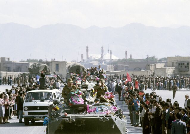 Kunduz residents bid farewell to Soviet troops heading home during the pullout from Afghanistan.