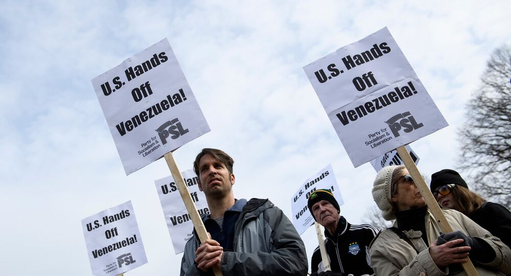 Activists rally against US intervention in Venezuela outside White House on January 26, 2019 in Washington, DC.
