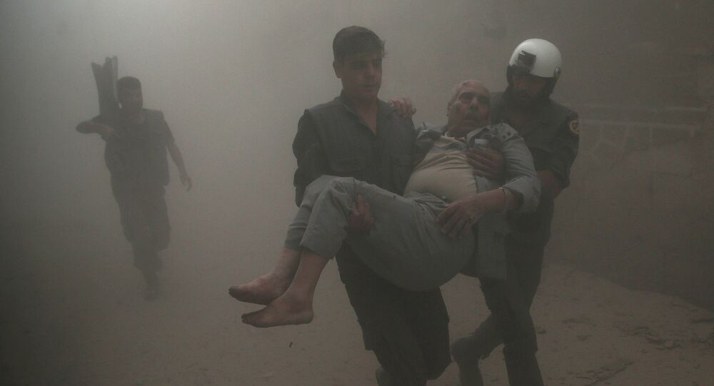Civil defense members carry an injured man after an air strike in the rebel-held Douma neighbourhood of Damascus, Syria October 12, 2016.