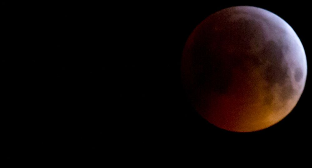 The Super Blood Wolf Moon eclipse in Antwerp, Belgium, Monday, Jan. 21, 2019. The eclipse takes place when the full moon is at or near the closest point in its orbit to Earth, a time popularly known as a supermoon. This means the Moon is deeper inside the umbra shadow and therefore may appear darker.