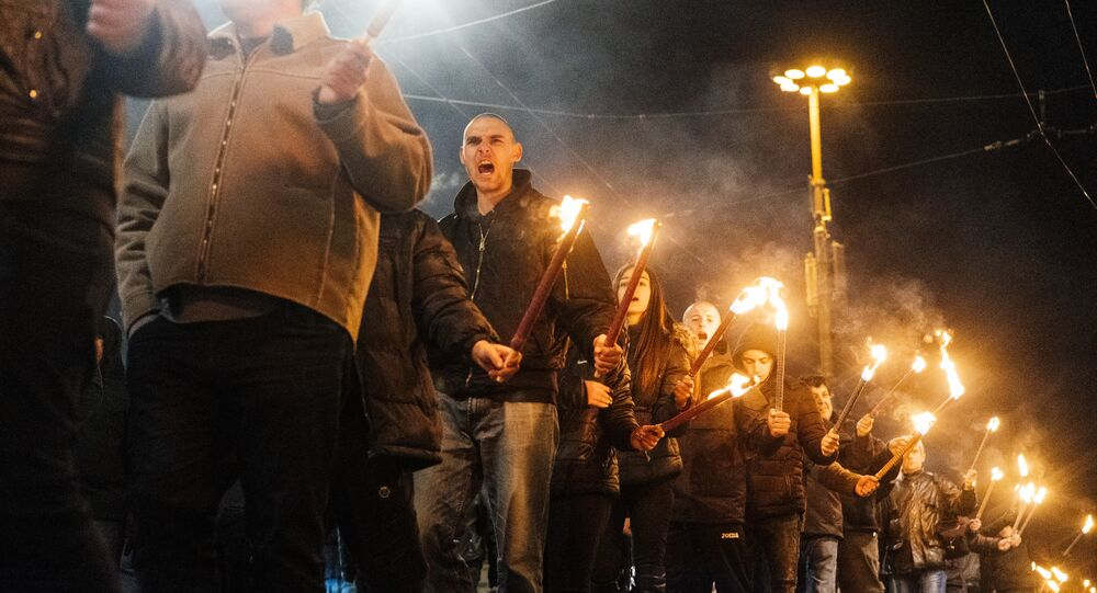 Activists parade with torches during a march to commemorate Bulgarian General and politician Hristo Lukov, in the centre of Sofia on February 16, 2019.
