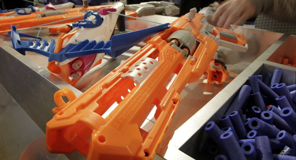 Nerf Accustrike Series Focus Fire Crossbow, left, and Alfa Hawk Blaster, right, from Hasbro, are shown at the ninth annual TTPM Holiday Showcase, in New York, Thursday, Oct. 6, 2016.