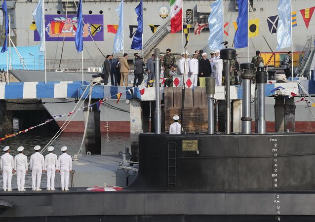 In this photo released by official website of the office of the Iranian Presidency, President Hassan Rouhani, centre with white turban, and other dignitaries attend the inauguration of Fateh, Conqueror in Persian, Iranian made a semi-heavy submarine in the southern port of Bandar Abbas, Iran, Sunday, Feb. 17, 2019.