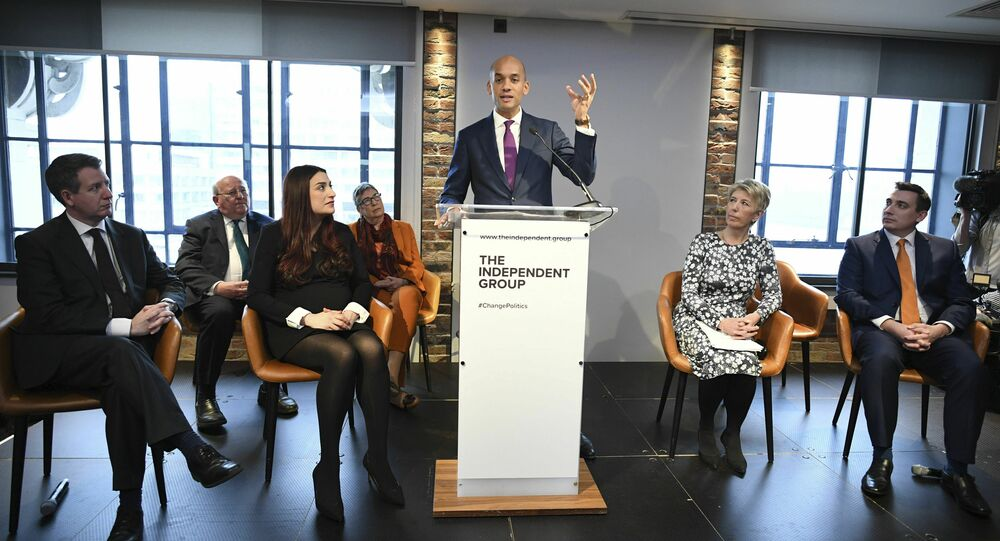 Labour MP Chuka Umunna, center, speaks to the media during a press conference with a group of six other Labour MPs, in London, Monday, Feb. 18, 2019.