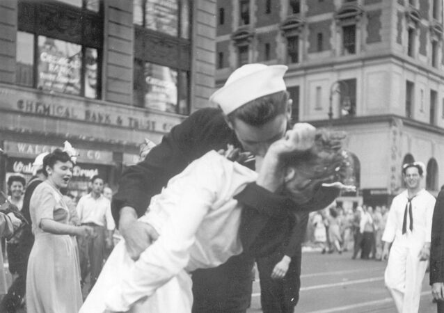 In this Aug. 14, 1945 file photo provided by the U.S. Navy, a sailor and a woman kiss in New York's Times Square, as people celebrate the end of World War II. The ecstatic sailor shown kissing a woman in Times Square celebrating the end of World War II has died. George Mendonsa was 95. This image was taken by U.S. Navy photographer Victor Jorgensen. The photo is of the same moment that photographer Alfred Eisenstaedt captured and first published in Life magazine