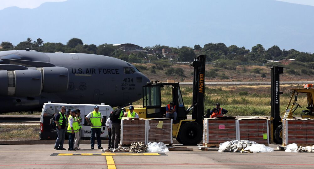Humanitarian aid for Venezuela is carried after being unloaded from a U.S. Air Force plane at Camilo Daza Airport in Cucuta, Colombia February 16, 2019