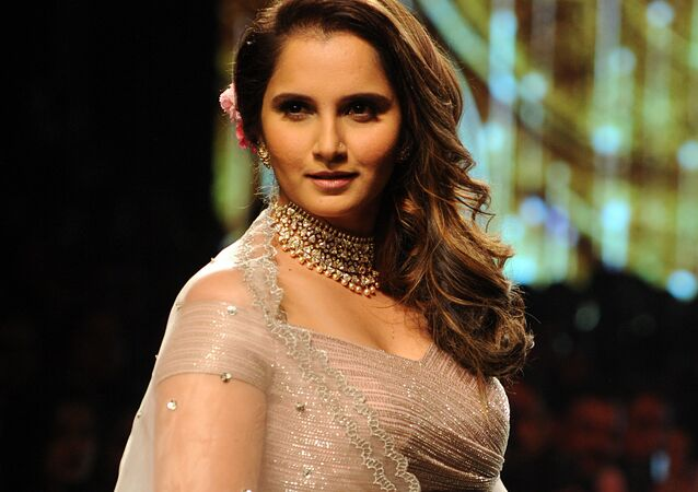 Indian tennis player Sania Mirza showcases a creation by designer Anushree Reddy at the Lakmé Fashion Week (LFW) Summer Resort 2018 in Mumbai on February 3, 2018
