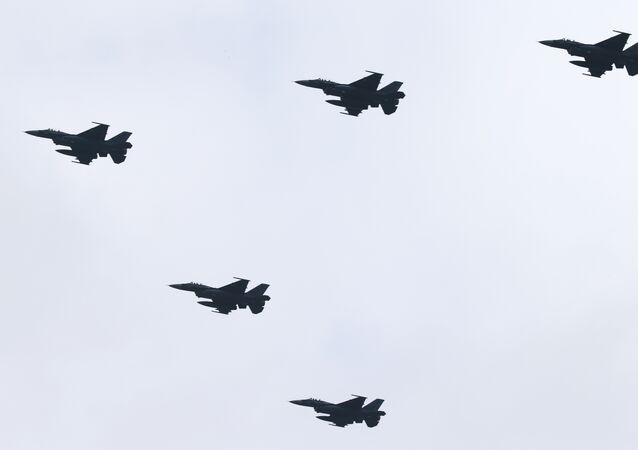 Japan's F-2 fighter jets fly in formation during the annual Self-Defense Forces Commencement of Air Review at Hyakuri Air Base, north of Tokyo, Sunday, Oct. 26, 2014.