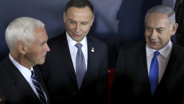 From left, United States Vice President Mike Pence, Poland's President Andrzej Duda and Israeli Prime Minister Benjamin Netanyahu talk after a group photo at the Royal Castle in Warsaw, Poland, Wednesday, Feb. 13, 2019 - Sputnik International