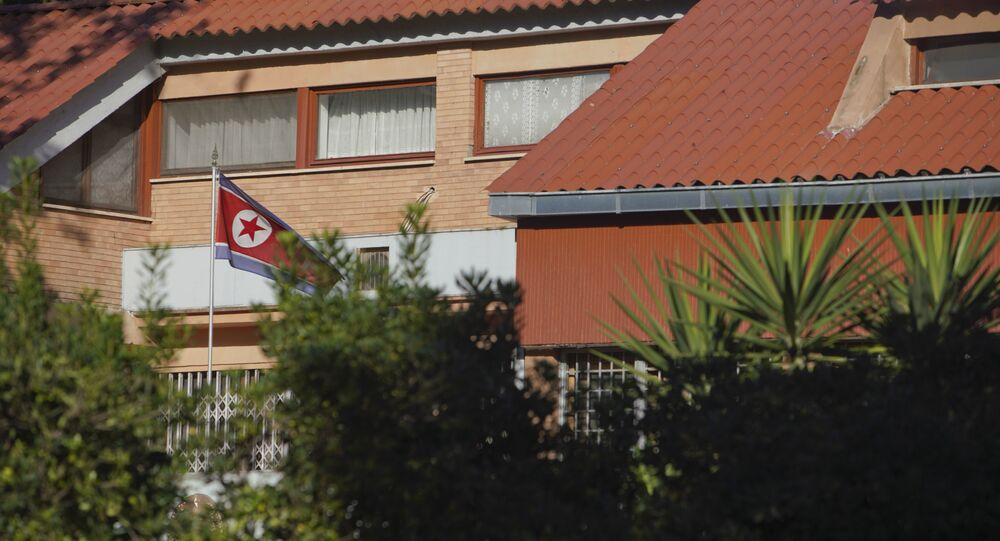 The flag of North Korea waves inside the compound of the North Korean embassy in Rome. File photo