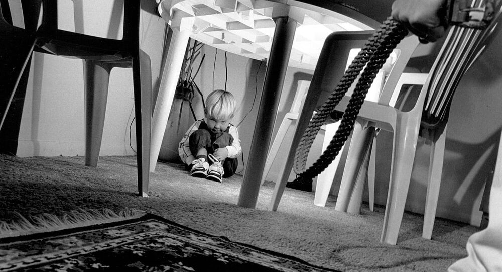 Honorable Mention Illustrative 'A Child's Black Cloud' by Staff Sgt. James D. Mossman, U.S. Air Force. This photograph was done for a story on child abuse. It is one of three photographs in a series and was taken with the intention off showing the fear and pain a child might experience at the hands of an abusive adult