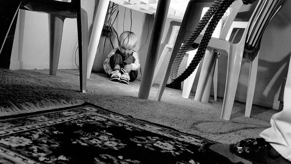 Honorable Mention Illustrative 'A Child's Black Cloud' by Staff Sgt. James D. Mossman, U.S. Air Force. This photograph was done for a story on child abuse. It is one of three photographs in a series and was taken with the intention off showing the fear and pain a child might experience at the hands of an abusive adult - Sputnik International