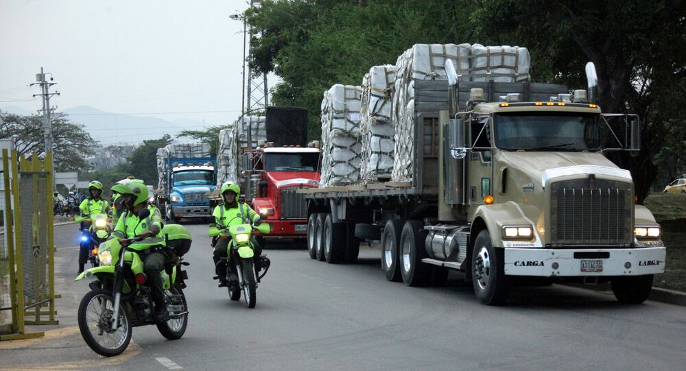 FILE PHOTO: Police escort trucks arriving at a warehouse, where international humanitarian aid for Venezuela will be stored according to authorities, near the Tienditas cross-border bridge between Colombia and Venezuela, in Cucuta, Colombia, Feb. 16, 2019.