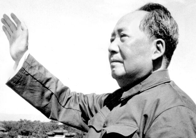 FILE - In this file photo taken in 1966, Mao Zedong waves at the beginning of China's Cultural Revolution. On May 16, 1966, the Communist Party's Politburo produced a document announcing the start of what was formally known as the Great Proletarian Cultural Revolution to pursue class warfare and enlist the population in mass political movements.