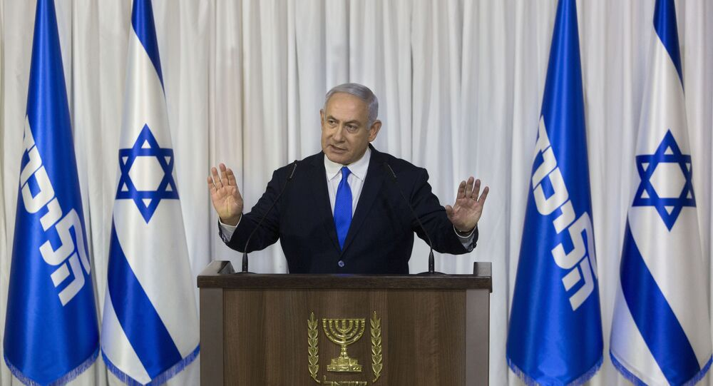 Israeli Prime Minister Benjamin Netanyahu gestures as he delivers a statement in Ramat Gan, Israel, Thursday, Feb. 21, 2019.
