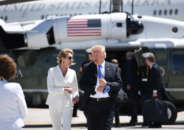 US President Donald Trump, with USAmbassador to Canada Kelly Knight Craft, walks to Air Force One prior to departure from Canadian Forces Base Bagotville in Canada, June 9, 2018.