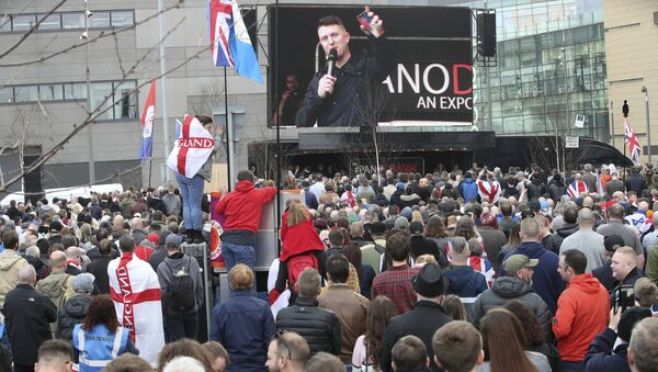 Former leader and founder of the English Defence League, Tommy Robinson seen on screen, as he addresses an EDL protest over a TV program, outside the BBC building in Salford, England, Saturday Feb. 23, 2019. - Sputnik International