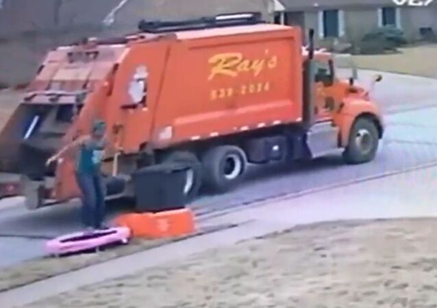 Trash Service Man Get Captured on Video While Jumping on Old Trampoline