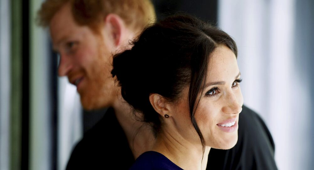 Britain's Prince Harry and Meghan, Duchess of Sussex smile during their visit to the National Kiwi Hatchery at Rainbow Springs in Rotorua, New Zealand, 31 October 2018