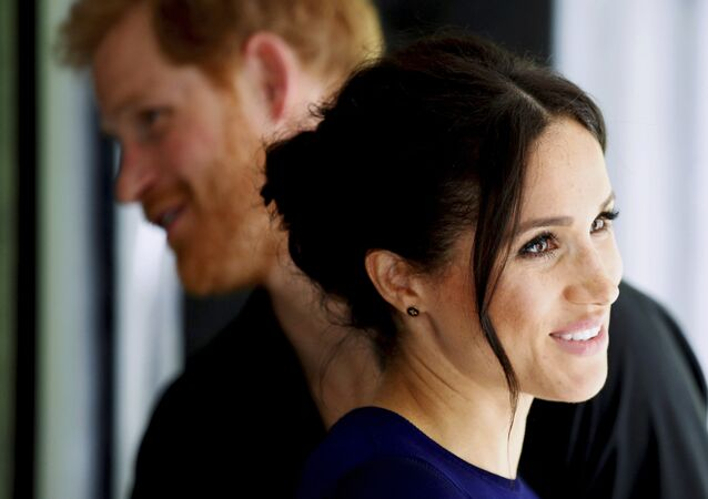 Britain's Prince Harry and Meghan, Duchess of Sussex smile during their visit to the National Kiwi Hatchery at Rainbow Springs in Rotorua, New Zealand, Wednesday, Oct. 31, 2018
