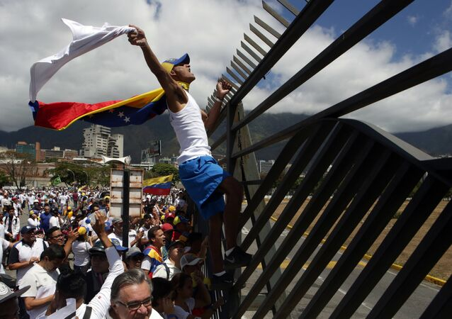 Supporters of Venezuelan opposition leader Juan Guaido take part in a march in Caracas, on February 23, 2019