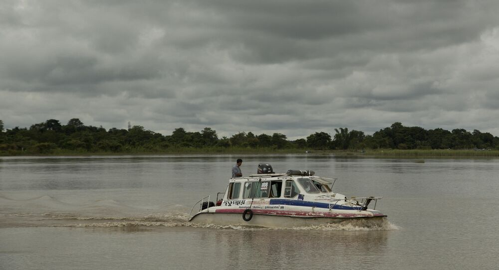 In this Aug. 8, 2018 photo, an ambulance boat crosses the Brahmaputra river in Majuli, in the northeastern Indian state of Assam