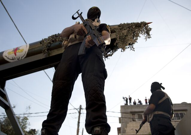 Palestinian members of the Al-Quds Brigades, the military wing of the Islamic Jihad group